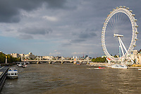 UK, England, London.  London Eye Ferris Wheel, Millenium Wheel, Thames River, Hungerford Bridge and Jubilee Bridges in background.
