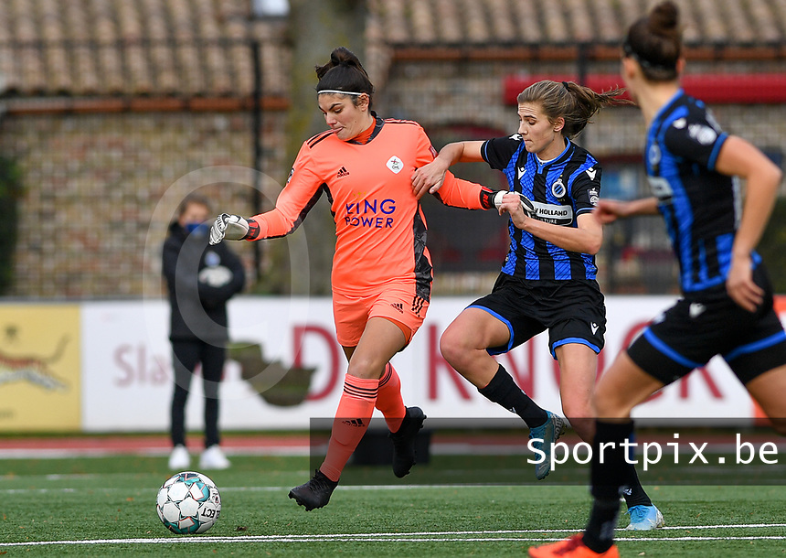 OHL's goalkeeper Louise Van Den Bergh pictured in a fight for the ball with Marie Minnaert (13 Brugge) during a female soccer game between Club Brugge Dames YLA and Oud Heverlee Leuven on the 8 th matchday of the 2020 - 2021 season of Belgian Scooore Womens Super League , saturday 21 th November 2020  in Knokke , Belgium . PHOTO SPORTPIX.BE | SPP | DAVID CATRY