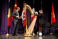 Andy Miller, left, and Lyon and Healy Technician John Papadolias move the Concert Grand Harp to the stage for the awards ceremony during the 11th USA International Harp Competition at Indiana University in Bloomington, Indiana on Saturday, July 13, 2019. (Photo by James Brosher)