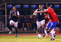 SAN JOSE, COSTA RICA - September 06, 2013: Jermaine Jones (13) and Clint Dempsey (8) of the USA MNT start an attack against the Costa Rica MNT during a 2014 World Cup qualifying match at the National Stadium in San Jose on September 6. USA lost 3-1.