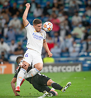 28th September 2021; Estadio Santiago Bernabeu, Madrid, Spain; Men's Champions League, Real Madrid CF versus FC Sheriff Tiraspol; Luka Jovic of Real Madrid tries to control the ball under the pressure of Cristiano of Sheriff