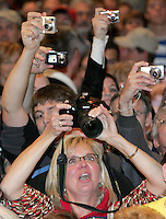 Supporters of Republican vice presidential candidate, Alaska Gov. Sarah Palin reach to get a camera angle on her during a campaign rally in Des Moines, Iowa Saturday, October 25, 2008.