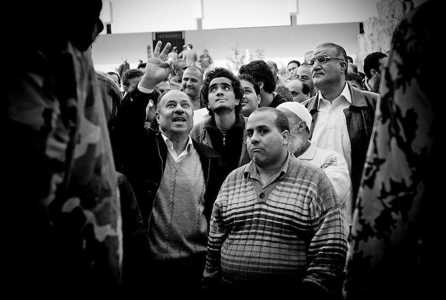 Egyptian voters wait in line at the polling station in Tawfikia Secondary School, Shubra, Cairo, Egypt, Monday, Nov. 28, 2011. Voting began on Monday in Egypt's first parliamentary elections since longtime authoritarian leader Hosni Mubarak was ousted in a popular uprising nine months ago. The vote is a milestone many Egyptians hope will usher in a democratic age after decades of dictatorship.