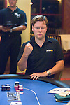 Johan Storakers moves all in and then pumps his first after winning the hand to stay alive and knocking out an opponent.