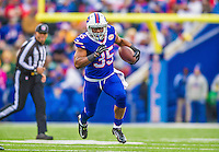 14 December 2014: Buffalo Bills running back Bryce Brown rushes for a 12-yard gain and a first down in the second quarter against the Green Bay Packers at Ralph Wilson Stadium in Orchard Park, NY. The Bills defeated the Packers 21-13, snapping the Packers' 5-game winning streak and keeping the Bills' 2014 playoff hopes alive. Mandatory Credit: Ed Wolfstein Photo *** RAW (NEF) Image File Available ***