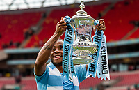 Raheem Sterling of Manchester City holds up the FA Cup during the FA CUP FINAL match between Manchester City and Watford at Wembley Stadium, London, England on 18 May 2019. Photo by Andy Rowland.