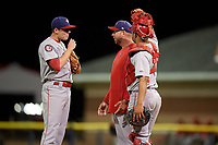 Auburn Doubledays pitching coach Tim Redding talks with relief pitcher Jared Brasher (10) and catcher Jeyner Baez (13) during a game against the Batavia Muckdogs on September 6, 2017 at Dwyer Stadium in Batavia, New York.  Auburn defeated Batavia 6-3.  (Mike Janes/Four Seam Images)