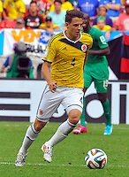 BRASILIA - BRASIL -19-06-2014. Santiago Arias jugador de Colombia (COL) en acción durante partido del Grupo C contra Costa de Marfil (CIV) por la Copa Mundial de la FIFA Brasil 2014 jugado en el estadio Mané Garricha de Brasilia./ Santiago Arias player of Colombia (COL) in action during the macth of the Group C against Costa de Marfil (CIV) for the 2014 FIFA World Cup Brazil played at Mane Garricha stadium in Brasilia. Photo: VizzorImage / Alfredo Gutiérrez / Contribuidor