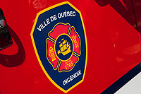 Ville de Quebec city firefighter logo is seen on a firetruck Friday April 8, 2011.