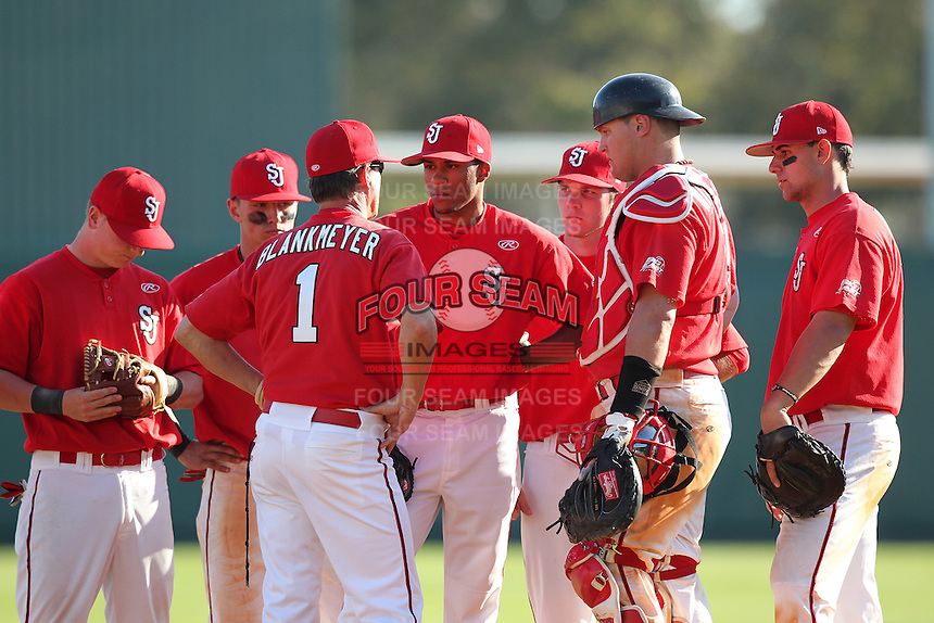 Head coach Ed Blankmeyer #1 of the St. John's Red Storm talks with (L-R) Sean O'Hare #3, Joe Panik #2, Jose Rodriguez #33, Matt Wessinger #00, Joe Witkowsi #9 and Paul Karmas #31 during the Big East-Big Ten Challenge vs. the Michigan Wolverines at Al Lang Field in St. Petersburg, Florida;  February 19, 2011.  St. John's defeated Michigan 13-6.  Photo By Mike Janes/Four Seam Images