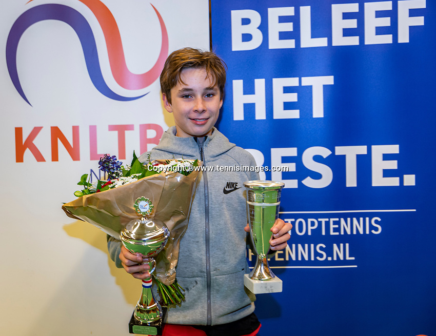 Wateringen, The Netherlands, December 1,  2019, De Rhijenhof , NOJK 12 and16 years, Winner boys 12 years: Mees Röttgering (NED) with the trophy<br /> Photo: www.tennisimages.com/Henk Koster