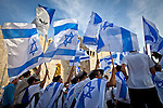 Israelis dance and wave flags outside Damascus gate in Jerusalem Wednesday May 28 2014, during festivities marking Jerusalem day. The Day marks the reunification of Jerusalem following the 1967 Six Day War when Israel captured the Arab part of the city from Jordan. Photo By Eyal Warshavsky
