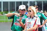 May 1, 2011; Baytown, TX, USA: NHRA funny car driver John Force and daughter Courtney Force during the Spring Nationals at Royal Purple Raceway. Mandatory Credit: Mark J. Rebilas-