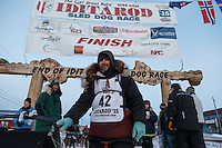 Richie Diehl poses for a photo after his finish at the burl arch in Nome on Thursday March 19, 2015 during Iditarod 2015.  <br /> <br /> (C) Jeff Schultz/SchultzPhoto.com - ALL RIGHTS RESERVED<br />  DUPLICATION  PROHIBITED  WITHOUT  PERMISSION