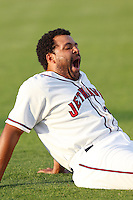 Brandon Meredith #23 of the Lancaster JetHawks yawns before a game against the Rancho Cucamonga Quakes at The Hanger on August 26, 2013 in Lancaster, California. Rancho Cucamonga defeated Lancaster, 4-1. (Larry Goren/Four Seam Images)