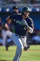 Vermont Lake Monsters third baseman Ryan Howell (4) runs to first during a game against the Batavia Muckdogs August 9, 2015 at Dwyer Stadium in Batavia, New York.  Vermont defeated Batavia 11-5.  (Mike Janes/Four Seam Images)