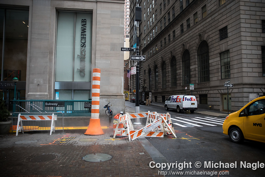 Empty sidewalks and streets are seen near the New York Stock Exchange (NYSE) during the coronavirus pandemic on March 17, 2020 in New York City. Photograph by Michael Nagle