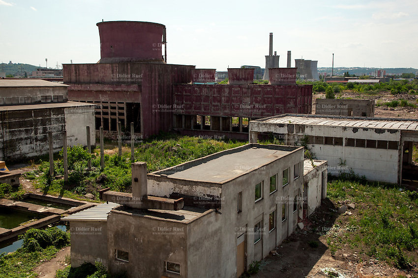 Romania. Iași County. Iași. Old industrial site's ruins dating from communism time. The factory used to be a beer factory. It is now deserted and will be soon be demolished by real estate speculators to build new shopping centers and malls. In the background, the thermal power stationis is running with only half of its full capacity. A thermal power station is a power plant in which the prime mover is steam driven. Water is heated, turns into steam and spins a steam turbine which drives an electrical generator. After it passes through the turbine, the steam is condensed in a condenser and recycled to where it was heated; this is known as a Rankine cycle. The greatest variation in the design of thermal power stations is due to the different fossil fuel resources generally used to heat the water. Some prefer to use the term energy center because such facilities convert forms of heat energy into electrical energy. Certain thermal power plants also are designed to produce heat energy for industrial purposes. Globally, fossil fueled thermal power plants produce a large part of man-made CO2 emissions to the atmosphere. Iași (also referred to as Iasi, Jassy or Iassy) is the largest city in eastern Romania and the seat of Iași County. Located in the Moldavia region, Iași has traditionally been one of the leading centres of Romanian social life. The city was the capital of the Principality of Moldavia from 1564 to 1859, then of the United Principalities from 1859 to 1862, and the capital of Romania from 1916 to 1918. 11.06.15© 2015 Didier Ruef