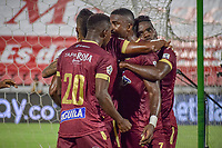 IBAGUE - COLOMBIA, 30-03-2021: Jugadores del Tolima celebran después de anotar el primer gol durante partido entre Deportes Tolima y Atlético Nacional por la fecha 16 como parte de la Liga BetPlay DIMAYOR I 2021 jugado en el estadio Manuel Murillo Toro de la ciudad de Ibagué. / Players of Tolima celebrate after scoring the first goal during match between Deportes Tolima and Atletico Nacional for the date 16 as part of BetPlay DIMAYOR League I 2021 played at Manuel Murillo Toro stadium in Ibague. Photo: VizzorImage / Joan Orjuela / Cont