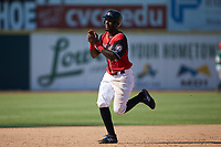 Sherten Apostel (13) of the Hickory Crawdads claps his hands as he rounds the bases following a home run by Pedro Gonzalez (not pictured) during the game against the Greensboro Grasshoppers at L.P. Frans Stadium on May 26, 2019 in Hickory, North Carolina. The Crawdads defeated the Grasshoppers 10-8. (Brian Westerholt/Four Seam Images)