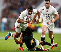Photo: Richard Lane/Richard Lane Photography. England v South Africa. QBE Autumn International. 15/11/2014. England's Kyle Eastman is tackled by South Africa's Pat Lambie.