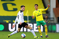 20th February 2021; Carrow Road, Norwich, Norfolk, England, English Football League Championship Football, Norwich versus Rotherham United; Dimitris Giannoulis of Norwich City nutmegs George Hirst of Rotherham United