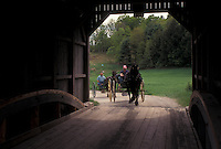 covered bridge, interior, Vermont, VT, Horses and carriages trotting through the Bowers or Brownsville Covered Bridge in West Windsor in the spring.