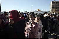 Pictured: A queue of migrants Thursday 03 March 2016<br /> Re: Migrants have been gathering at the port of Piraeus, near Athens, Greece