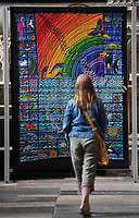 BNPS.co.uk (01202) 558833<br /> Pic: ZacharyCulpin/BNPS<br /> <br /> 8 million stitches, 1 Holy Exhibition<br /> <br /> Pictured: A visitor with an embroidery entitled, 'Water and sky – splash with colour!'<br /> from Genesis 1.20-23<br /> <br /> Twelve large embroidered panels fashioned from eight million stitches which tell the story of 'the Creation' have gone on display at Salisbury Cathedral.<br /> <br /> The panels, which measure up to 8ft by 11ft, are made from silk, hand-dyed materials, gold leaf and metallic leathers.<br /> <br /> They have been created by Devon-based textile artist Jacqui Parkinson who has dedicated three years to the solo project.<br /> <br /> The panels are inspired by the poetic verses of Genesis, the first book in the Bible, and include depictions of the Garden of Eden.