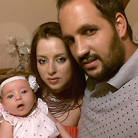 Pictured: Valantis Barkas (R), the son of digger driver Konstantinos Barkas with his wife Ioanna and daughter in Kos, Greece.<br /> Re: The search for missing Ben Needham led by South Yorkshire Police has concluded on the Greek island of Kos.<br /> Ben, from Sheffield, was 21 months old when he disappeared on 24 July 1991 during a family holiday.<br /> Digging took place around the farmhouse where Ben Needham was last seen and at a new site after a fresh line of inquiry suggested he could have been crushed by a digger.