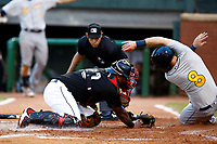Mac James (8) of the Montgomery Biscuits avoids the tag attempt of Chattanooga Lookouts catcher Brian Navarreto (20) as home plate umpire David Martinez looks on at AT&T Field on May 28, 2018 in Chattanooga, Tennessee. (Andy Mitchell/Four Seam Images)