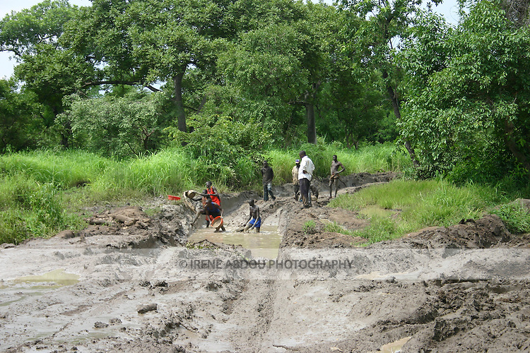 The South Sudanese road leading from Rumbek south to Uganda bears spots of deep mud at various points along the way.