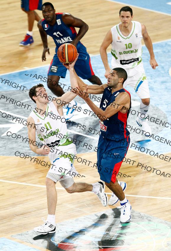 "Goran Dragic of Slovenia (L) and Nicolas Batum of France (R) in action during European basketball championship ""Eurobasket 2013"" quarter-final basketball game between Slovenia and France in Stozice Arena in Ljubljana, Slovenia, on September 18. 2013. (credit: Pedja Milosavljevic  / thepedja@gmail.com / +381641260959)"