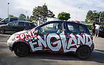 A decorated England supporters car at a service station just outside Lens in France this morning as fans start to arrive ahead of the match this afternoon.