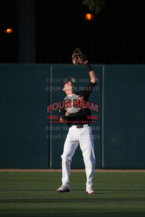 Corey Dempster (15) of the Southern California Trojans catches a fly ball during a game against the Arizona State Sun Devils at Dedeaux Field on March 24, 2017 in Los Angeles, California. Southern California defeated Arizona State, 5-4. (Larry Goren/Four Seam Images)