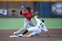 Batavia Muckdogs shortstop Dalvy Rosario (17) throws to first base as Jared Triolo (23) slides in during a NY-Penn League game against the West Virginia Black Bears on August 29, 2019 at Monongalia County Ballpark in Morgantown, New York.  West Virginia defeated Batavia 5-4 in ten innings.  (Mike Janes/Four Seam Images)