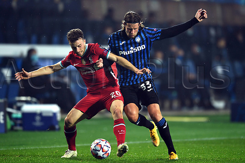 3rd November 2020; Bergamo, Lombardy, Italy. UEFA Champions League football, group stages, Atalanta versus Liverpool FC;  Hans Hateboer (ata) held off by Diogo Jota (Liv)