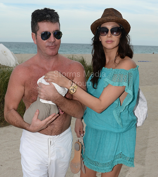 SMG_Simon Cowell_Lauren Silverman_Eric Cowell_FLXX_Beach_Newborn_Baby_022414_01.JPG<br /> <br /> MIAMI, FL - FEBRUARY 24: New parents Simon Cowell and Lauren Silverman enjoy the Miami beach with their Yorkshire Terriers, Sqiddly and Diddly.  Cowell and Silverman welcomed their son on Valentine's Day 10 days ago on February 24, 2014 in Delray Beach, Florida.    (Photo By Storms Media Group) <br /> <br /> People:  Simon Cowell_Lauren Silverman_Eric Cowell<br /> <br /> Transmission Ref:  FLXX<br /> <br /> Must call if interested<br /> Michael Storms<br /> Storms Media Group Inc.<br /> 305-632-3400 - Cell<br /> 305-513-5783 - Fax<br /> MikeStorm@aol.com<br /> www.StormsMediaGroup.com
