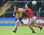 Martin Mc Mahon of Clare in action against Donal Og Hodnett of Cork during their National Football League game at Cusack Park. Photograph by John Kelly.