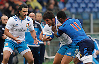 Rugby, Torneo Sei Nazioni: Italia vs Francia. Roma, stadio Olimpico, 15 marzo 2015.<br /> Italy's Giovanbattista Venditti, center, is challenged by France's Noa Nakaitaci, right, during the Six Nations championship rugby match between Italy and France at Rome's Olympic stadium, 15 March 2015.<br /> UPDATE IMAGES PRESS/Riccardo De Luca