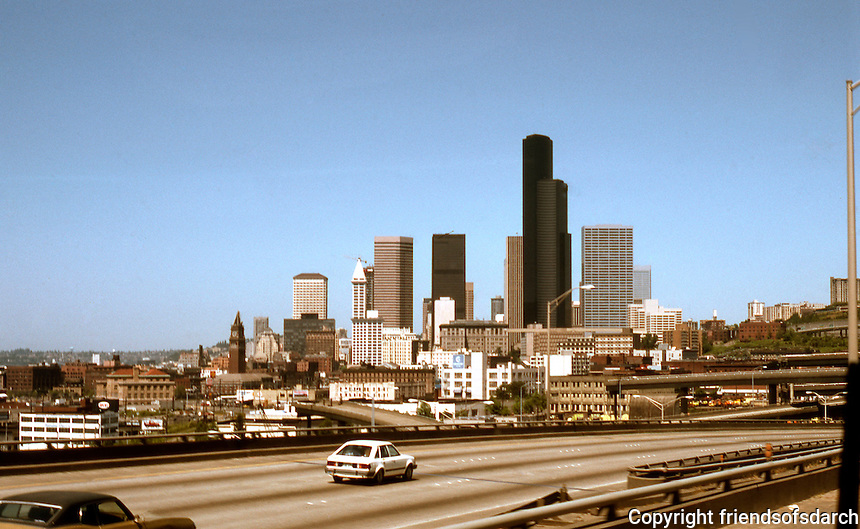 Seattle: Panorama of Downtown from I-5 through bus window, 1986. Note: Smith Tower to left and in black, the huge Columbia Center.