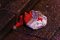 A discarded Santa hat in Wind Street, Swansea, Wales  on Mad Friday, Booze Black Friday or Black Eye Friday, the last Friday night before Christmas Day, when traditionally people in the UK go out to celebrate the start of their holidays. Friday 22 December 2017