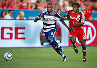 FC Dallas defender/midfielder Jackson Goncalves #6 and Toronto FC defender Danleigh Borman #25 in action during an MLS game between the FC Dallas and the Toronto FC at BMO Field in Toronto on July 20, 2011.