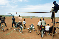 Eritrea. Southern Debud Zone. Mendefera. Football game on sunday morning. The local Mendera team plays againt an indian team. The indians will win by 5 goalks to 1. Spectators sit on the goal. The indian squad belongs to the UNMEE (United Nations Mission Ethiopia Eritrea). The batallion from India is based and works in the Temporary Security Zone (TSZ) which follows on both sides the border between Eritrea and Ethiopia. The TSZ was created after the signature of a cease fire between the two countries. The war lasted from 1999 to 2001 on a border dispute.             © 2002 Didier Ruef