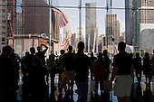 New  York, New York.September 10, 2011..Views of Ground Zero on the eve of the 10th anniversary of 9-11-2001. People look down at the site from Three Wold Financial Center.