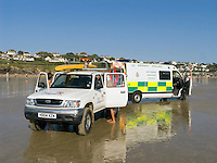 Paramedics and RNLI Lifeguards working together treat a young boy who has broken his leg whilst surfing. This image may only be used to portray the subject in a positive manner..©shoutpictures.com..john@shoutpictures.com