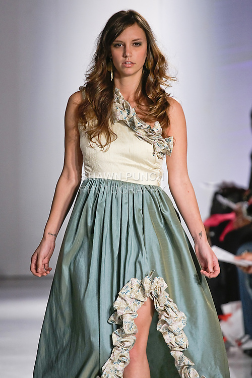 Model walks the runway in an outfit by Caroline J Smith, from her Janie G Couture Spring 2012 collecion, during BK Fashion Weekend Spring Summer 2012.