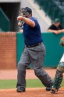 Home plate umpire Bryan Dormaier punches out a batter on a called third strike at NewBridge Bank Park June 20, 2009 in Greensboro, North Carolina. (Photo by Brian Westerholt / Four Seam Images)