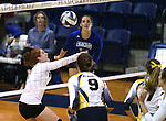 Marymount's Cassidie Watson passes to Erin Allison in a college volleyball game against St. Mary's in Lexington Park, MD, on Wednesday, Oct. 29, 2014. Marymount won 3-2 to go 24-9 on the season.<br /> Photo by Cathleen Allison