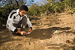 Arabian Leopard (Panthera pardus nimr) researcher Waleed Al'Rail photographing track, Hawf Protected Area, Yemen